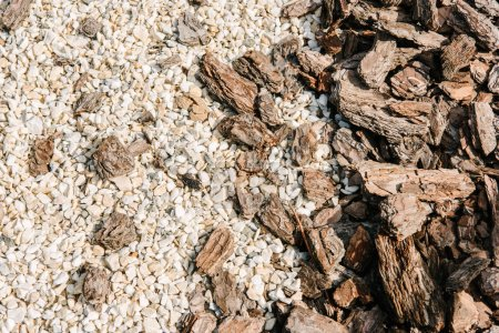 pieces of wooden bark and white pebbles for background