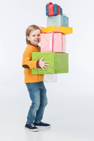 smiling boy with wrapped gifts isolated on white