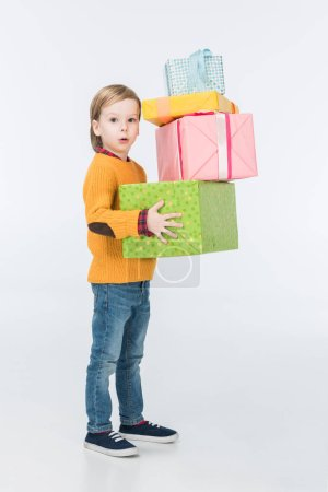 surprised boy with wrapped gifts isolated on white
