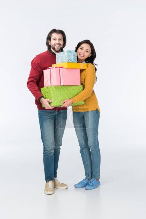 smiling couple with wrapped presents looking at camera isolated on white