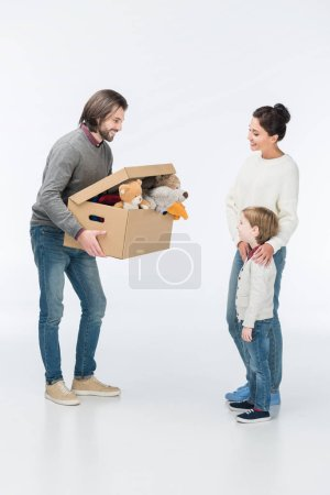 Photo for Happy father holding cardboard box with toys isolated on white - Royalty Free Image