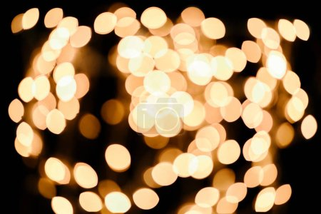bright defocused bokeh lights on black background