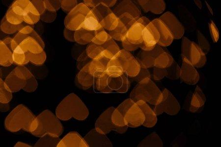 golden hearts bokeh lights on black backdrop