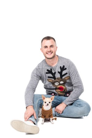 smiling man in festive winter sweater with little chihuahua dog isolated on white
