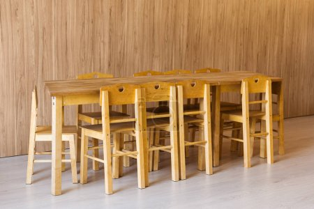wooden table and small chairs in kindergarten room