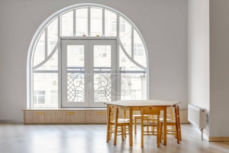 wooden table with chairs in light minimalistic kindergarten room