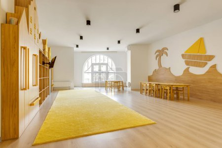 cozy light classroom with wooden furniture in modern kindergarten