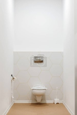 clean white toilet bowl in toilet in modern kindergarten