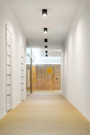empty hallway with doors and lamps in kindergarten