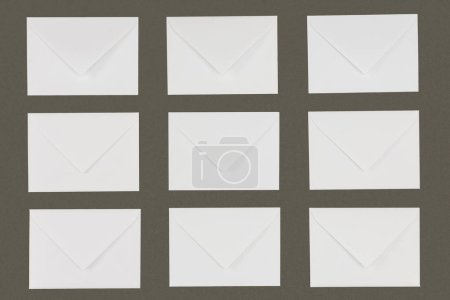 close-up view of white envelopes arranged isolated on grey background