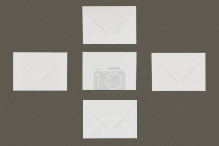 top view of white envelopes arranged isolated on grey background