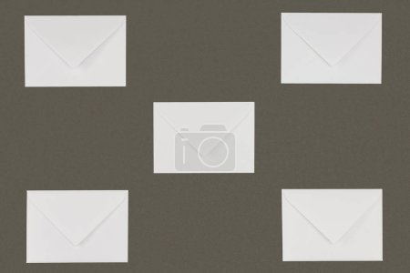 close-up view of closed white envelopes isolated on grey background