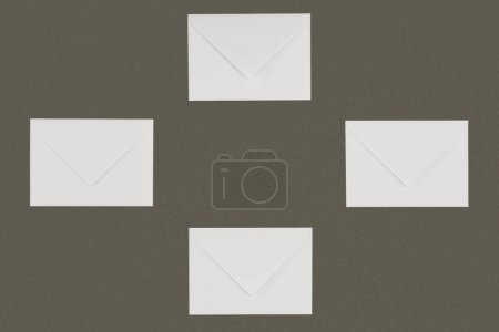 Photo for Close-up view of closed white letters isolated on grey background - Royalty Free Image