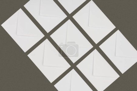 Photo for Top view of closed white letters isolated on grey background - Royalty Free Image