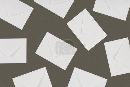 top view of closed white envelopes isolated on grey background