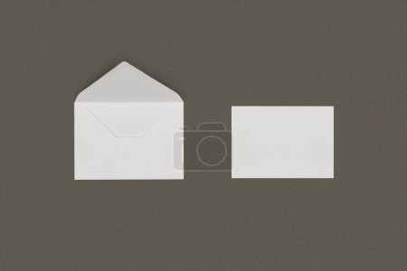 close-up view of open white envelope and blank card isolated on grey background