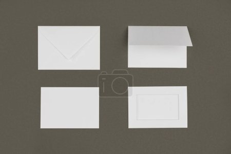 top view of white envelopes and cards isolated on grey
