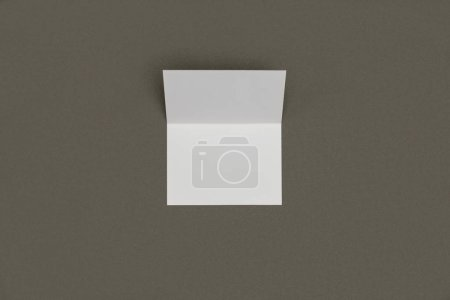top view of blank white card isolated on grey background