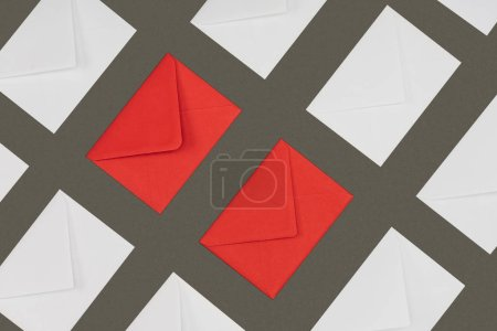 closed red and white envelopes isolated on grey background