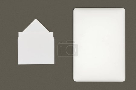 top view of white envelope and digital tablet isolated on black