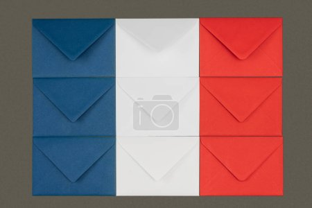 Flag of France made from white, blue and red envelopes isolated on black