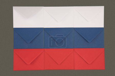 russia flag made from white, blue and red envelopes isolated on black