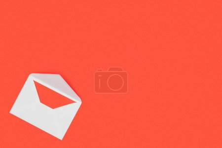 top view of open white envelope with red card isolated on red background