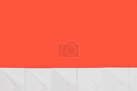 closed white envelopes isolated on red background