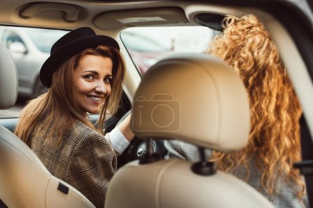Photo for Portrait of smiling woman driving car while her female friend sitting near - Royalty Free Image