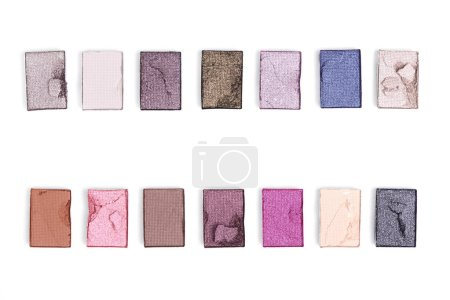 flat lay with arranged bright eyeshadows isolated on white