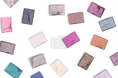 flat lay with arranged various eyeshadows on white backdrop