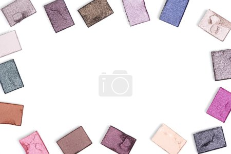 flat lay with arranged eyeshadows of various colors isolated on white