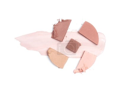 top view of blush of brown, pink and beige shades with stroke on white background