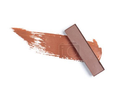 top view of eyeshadow of brown color with stroke on white background