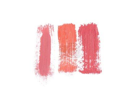 Photo pour Vue de dessus des traits de rouge à lèvres isolé sur blanc - image libre de droit