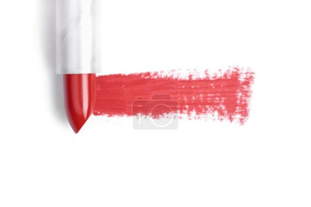 top view of red lipstick stroke on white backdrop