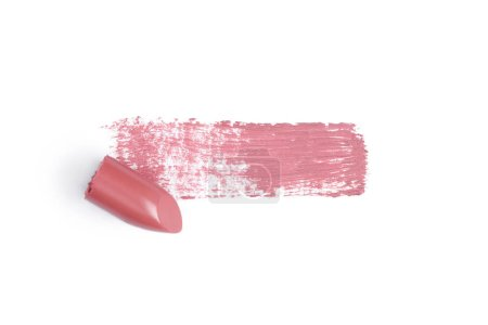 top view of pink lipstick stroke on white backdrop