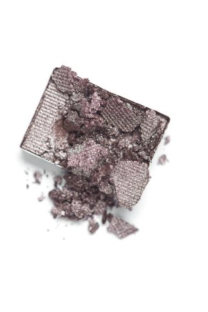 top view of cracked grey eyeshadow on white backdrop