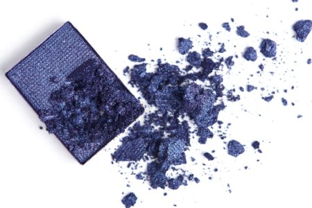 top view of cracked blue eyeshadow on white backdrop