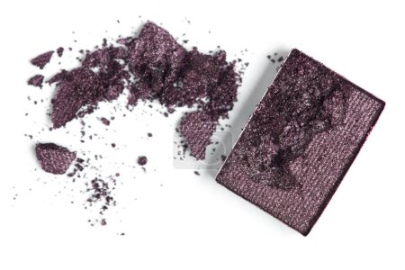 top view of cracked dark eyeshadow on white backdrop