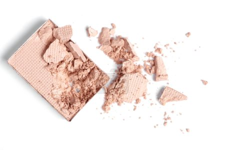 top view of cracked beige eyeshadow on white backdrop