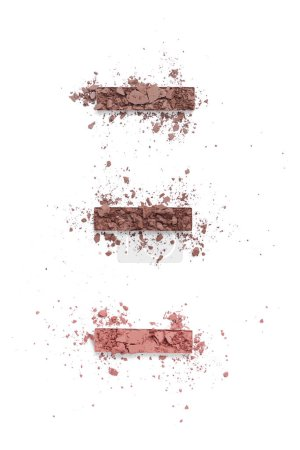 flat lay with arranged eyeshadows of brown shades isolated on white