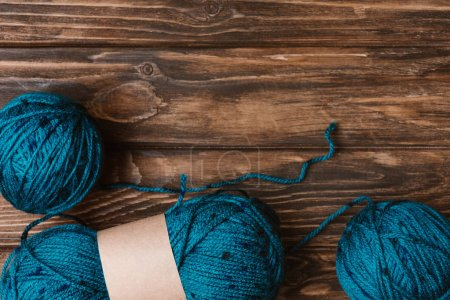 flat lay with blue yarn clews on wooden surface