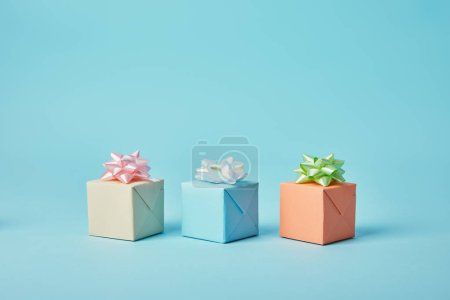 Photo for Different gifts with bows on blue background - Royalty Free Image