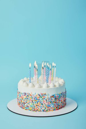 Photo for Tasty birthday cake with lighting candles on blue background - Royalty Free Image