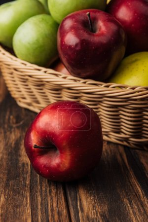 Photo for Red delicious apple with fruit wicker basket at background - Royalty Free Image