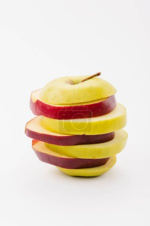 Photo for Fresh sliced red and golden delicious apples on white background - Royalty Free Image
