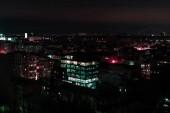 """Постер, картина, фотообои """"Темный город ночью с подсветкой windows"""""""
