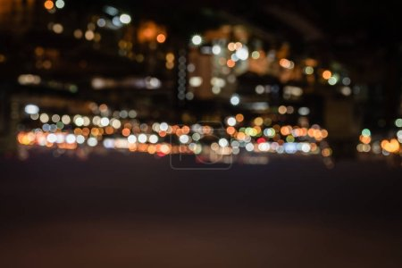 blurred buildings with bright bokeh lights at night