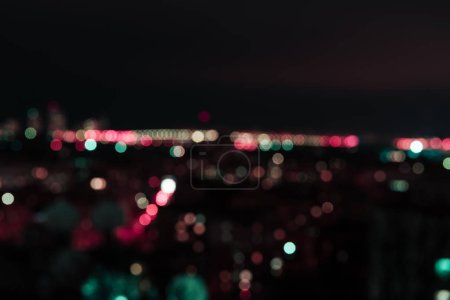 defocused background at night with colorful bokeh lights